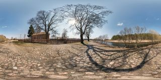 Full seamless spherical hdri panorama 360 degrees angle view on gravel road near brick house in village near river in stock images
