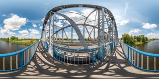 Full seamless spherical hdri panorama 360 degrees angle view near steel frame construction of huge bridge across river  in. Equirectangular projection. VR  AR royalty free stock images