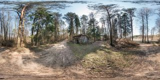 Full seamless spherical hdri panorama 360 degrees angle view near stone abandoned ruined military bunker building in pine forest royalty free stock images
