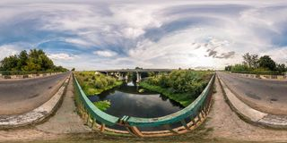 Full seamless spherical panorama 360 by 180 angle view near big huge bridge across river in equirectangular projection, skybox VR. Virtual reality content royalty free stock photos