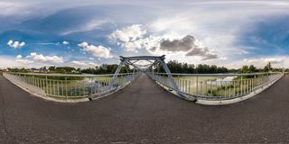 Full seamless spherical panorama 360 by 180 angle view neariron steel frame construction of pedestrian bridge across the river in. Equirectangular projection stock image