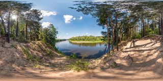 Full seamless spherical panorama 360 by 180 angle view on the precipice of a wide river in sunny summer day in equirectangular stock images
