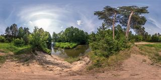 Full seamless spherical panorama 360 by 180 angle view on the shore of small river in sunny summer day in equirectangular stock photography