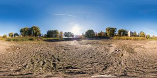 Full seamless spherical panorama 360 degrees angle view at the bottom of dried up pond in garden of residential area in royalty free stock image