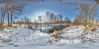 Full seamless spherical panorama 360 by 180 degrees angle view near a narrow fast river in a winter sunny evening in. Equirectangular projection, skybox VR AR royalty free stock photography