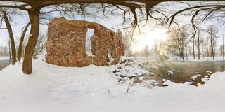 Full seamless spherical panorama 360  degrees angle view near ruined water mill narrow fast river in a winter sunny evening. 360 royalty free stock image