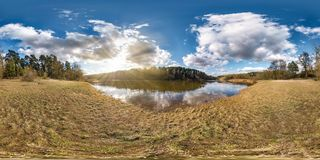 Full seamless spherical panorama 360 degrees angle view on the shore of wide river neman in evening with beautiful clouds in. Equirectangular projection, ready royalty free stock photography