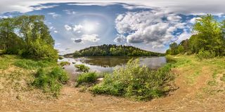 Full seamless spherical panorama 360 degrees angle view on the shore of wide river neman with halo and beautiful clouds in royalty free stock photo