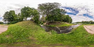 Full seamless spherical panorama 360 by 180 degrees angle view on the shore of width river near the bridge in summer day in. Equirectangular projection, ready stock photo