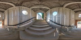 Full seamless spherical panorama 360 degrees angle view  in wooden tunnel with concrete staircase  in equirectangular projection, royalty free stock images