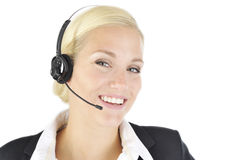 Full service woman. Blonde woman in headset and suit Royalty Free Stock Photography