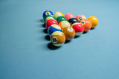 A full set of pool balls on pool table.  Stock Photos