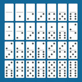 Full set of white dominoes with shadows on a blue background. Complete double-six set Stock Photography