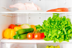 Full shelf of the refrigerator. Fresh vegetables and a bird on the shelf of the refrigerator a horizontal picture Stock Image
