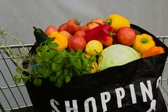 Full shopping bag of groceries in trolley chart stock images