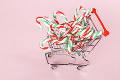 Full shopping cart with candy cane Royalty Free Stock Photos