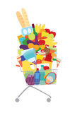 Full shopping cart. Shopping cart full of foods, bottles and boxes Stock Image