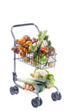 Full shopping grocery cart. Isolated on white background. Full shopping trolley Isolated on white background stock photography