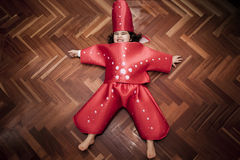 Full shot of a girl in a sea star costume Stock Image