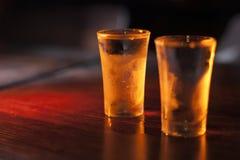Full shot glasses of vodka. Royalty Free Stock Photos