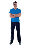Full shot of a guy with crossed arms Royalty Free Stock Images