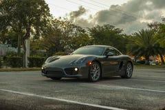 Full shot Porsche Cayman. Night scene. Royalty Free Stock Photo