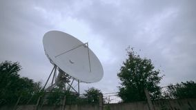 Full shot of the satellite array with trees. View of the satellite array with trees stock video footage