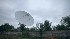 Full shot of the satellite array with trees. View of the satellite array with trees stock video