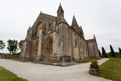 Full side  view of Aulnay de Saintonge church. In Charente Maritime region of France Stock Photo