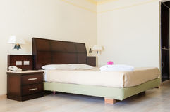 Full Size Bed in a Room at a Luxury Resort Hotel Royalty Free Stock Photos
