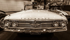 Full-size car Chevrolet Impala Convertible, 1960. STUTTGART, GERMANY - MARCH 02, 2017: Full-size car Chevrolet Impala Convertible, 1960. Sepia. Europe`s Royalty Free Stock Images