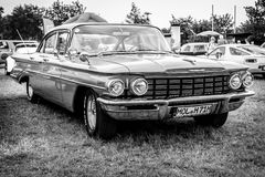 Full-size car Oldsmobile Dynamic 88, 1960. PAAREN IM GLIEN, GERMANY - JUNE 03, 2017: Full-size car Oldsmobile Dynamic 88, 1960. Black and white. Exhibition `Die Royalty Free Stock Image