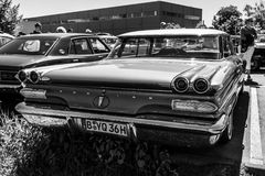 Full-size car Pontiac Catalina sedan, 1960. BERLIN - MAY 06, 2018: Full-size car Pontiac Catalina sedan, 1960. Rear view. Black and white. Oldtimertage Berlin Stock Image