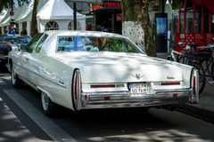 Full-size luxury car Cadillac Coupe de Ville fourth generation, 1975. Rear view. Royalty Free Stock Images