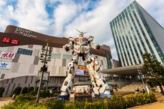 Full-size Mobile suit RX-0 Unicorn Gundam Performances at Diver City plaza Tokyo, Odaiba, Tokyo, Japan. Tokyo, Japan - October 18, 2018: Full-size Mobile suit RX royalty free stock images