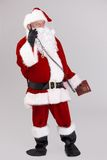 Full size photo of Santa talking on phone Stock Images