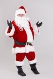Full size portrait of surprised Santa Claus. Looking at camera, isolated on gray background stock photos
