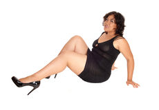 A full size woman sitting on floor. Royalty Free Stock Image