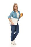 Full size young woman with laptop and coffee Royalty Free Stock Photos