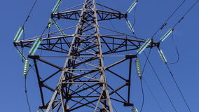 Full-sized electric support with high-voltage wires. Vertical panorama. Renewable energy sources, electrical networks. Substations and generators stock footage