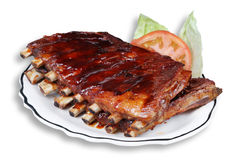 Full Slab Ribs. Barbecue beef slab ribs on white plate Stock Photos