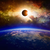 Full solar eclipse. Abstract scientific background - planet Earth in space, full solar eclipse, red glowing galaxy. Elements of this image furnished by NASA nasa stock photography