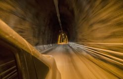 Full speed inside a carved tunnel. At full speed inside a carved tunnel Royalty Free Stock Image