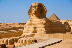 Full Sphinx Profile Pyramid Giza Egypt. The full profile of the Great Sphinx with the pyramid of Menkaure in the background in Giza, Egypt stock images