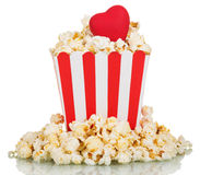 Full square box of popcorn with a red heart isolated on white Stock Photo