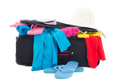 Full suitcase with clothes and passports Royalty Free Stock Photography