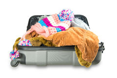 Full suitcase with clothes on white background. Full suitcase with clothes on white Royalty Free Stock Photos