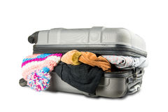 Full suitcase with clothes on white background. Full suitcase with clothes on white Stock Images