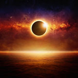 Full sun eclipce. Abstract fantastic background - full sun eclipse, glowing horizon above red ocean, end of world. Elements of this image furnished by NASA stock image