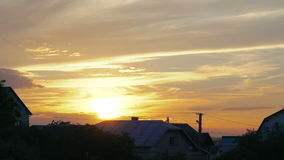 Full sunset over house with lights turning on and off as night falls. In full HD stock footage